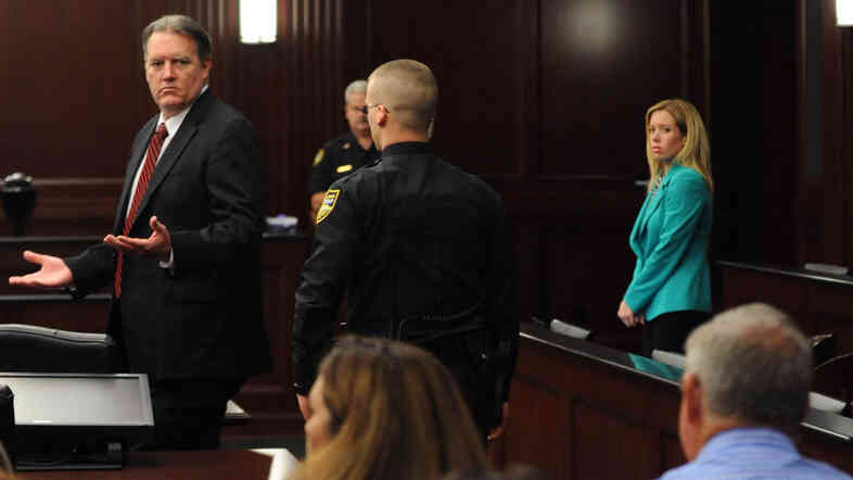 Michael Dunn reacts after the verdict is read in Jacksonville, Fla., on Saturday. Dunn was convicted of attempted murder in the shooting death of a teenager over an argument over loud music, but jurors could not agree on the most serious charge of first-degree murder.