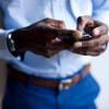 Close up of businessman using cellphone