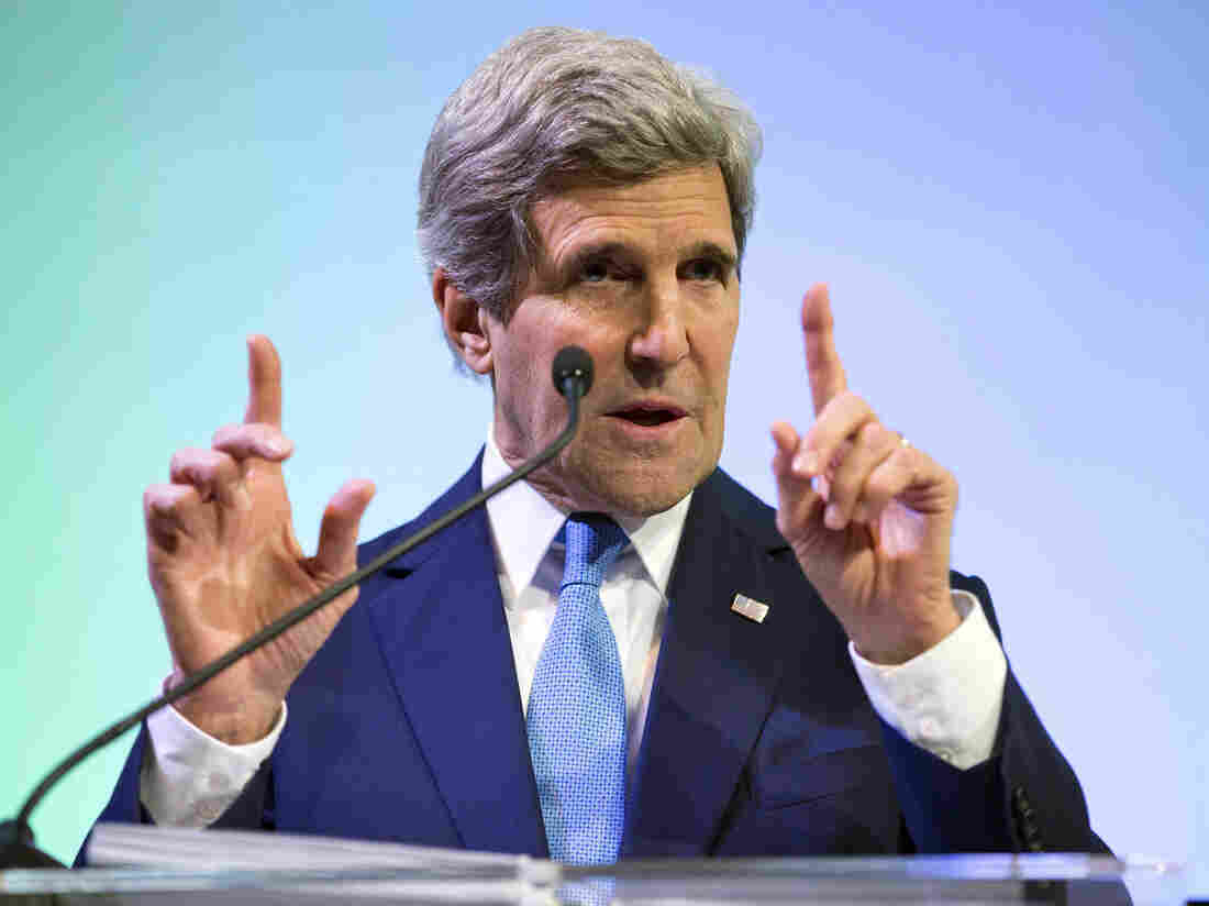 Secretary of State John Kerry gestures while speaking about climate change in Jakarta on Sunday.