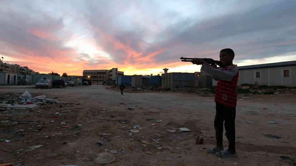 A child from the town of Tawargha holds a toy gun at a refugee camp in Benghazi on Jan. 12. His town was cleared by militiamen who accused resident