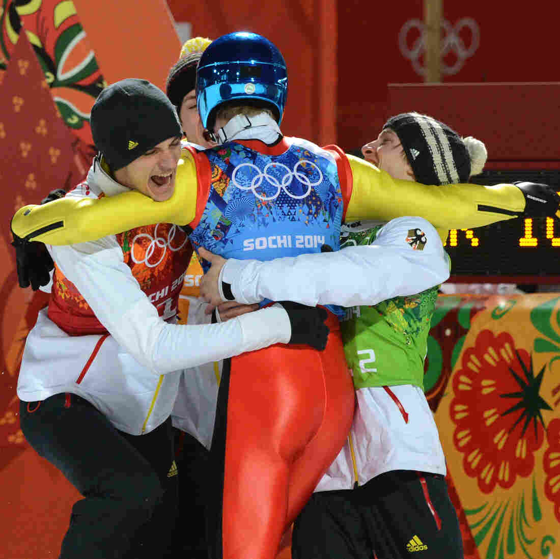 Germany's Severin Freund celebrates with teammates after competing to win gold in the men's team ski jumping competition at the Sochi Winter Olympics on Monday.