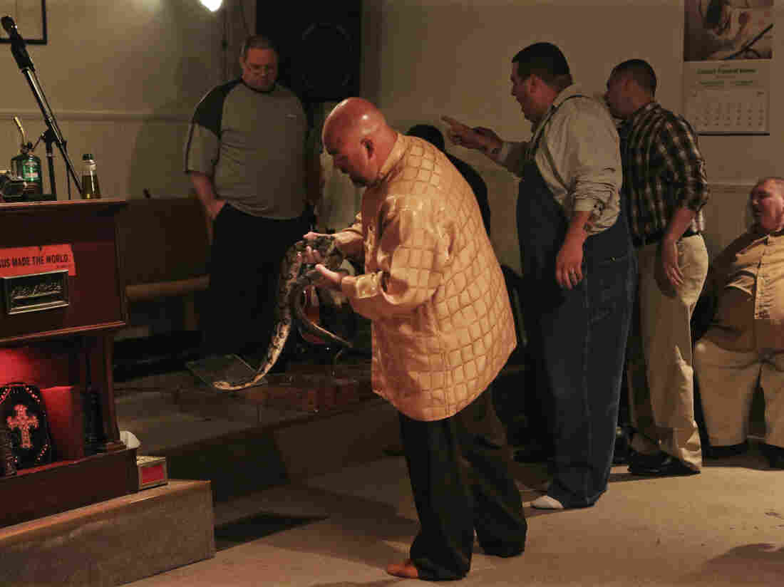Pastor Jamie Coots holds a snake at Full Gospel Tabernacle in Jesus Name Church in Middlesboro, Ky., last year.
