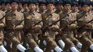 North Korean soldiers marching through Kim Il-Sung Square in Pyongyang.