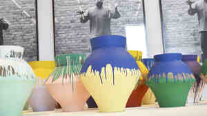 "Chinese artist Ai Weiwei's ""Colored Vases"" is shown on display in December at the Perez Art Museum Miami. One of the vases in the exhibit was smashed Sunday."
