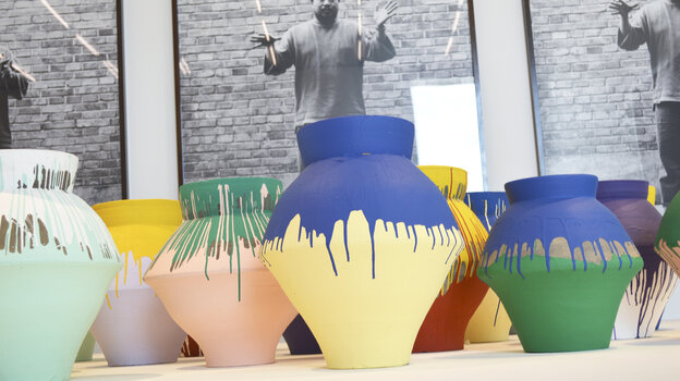"""Chinese artist Ai Weiwei's """"Colored Vases"""" is shown on display in December at the Perez Art Museum Miami. One of the vases in the exhibit was smashed Sunday."""