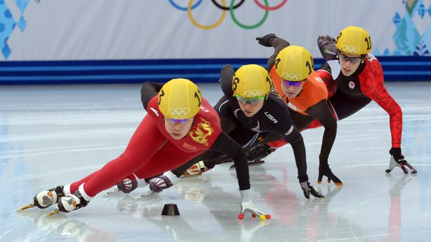 U.S. skater Jessica Smith, in black, is among the Americans who have been kept off the podium in Sochi despite strong performances leading up to the Winter Games. Smith's private coach is Jae Su Chun, who is under a two-year suspension from the International Skating Union.