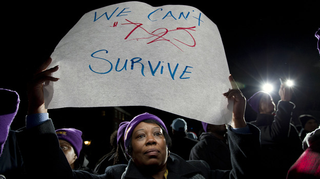 Darlene Handy of Baltimore holds up a banner at a rally supporting a pay measure in Maryland. More than 20 states have raised minimum pay rates above the federal level. (AP)