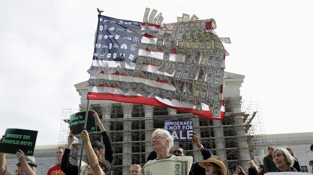 Demonstrators gather outside the Supreme Court in Washington in October 2013, as the court heard arguments on campaign finance.