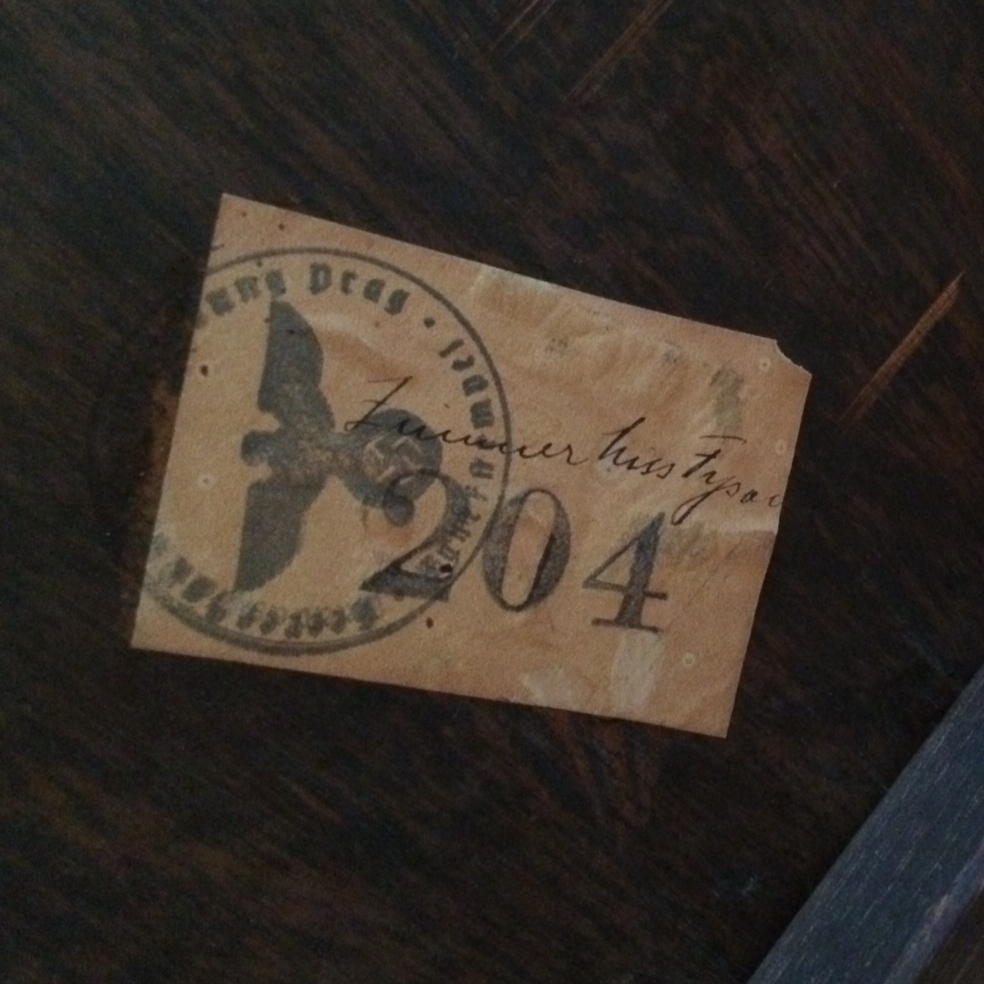 During World War II, the Nazi secret police occupied a palace in Prague that is now the residence for the U.S. ambassador to the Czech Republic. Underneath an antique table at the residence is a Nazi sticker showing an iron eagle with a swastika and a serial number.
