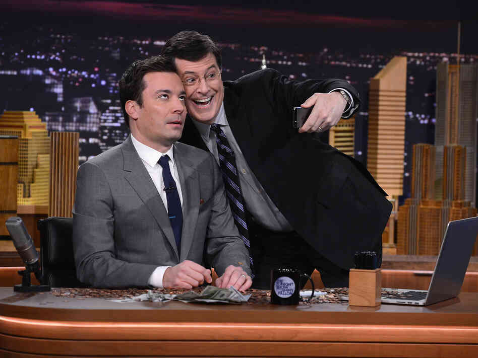 "Stephen Colbert visits The Tonight Show for Jimmy Fallon's debut --€"" and pays up the $100 he bet that Fallon would never host it."