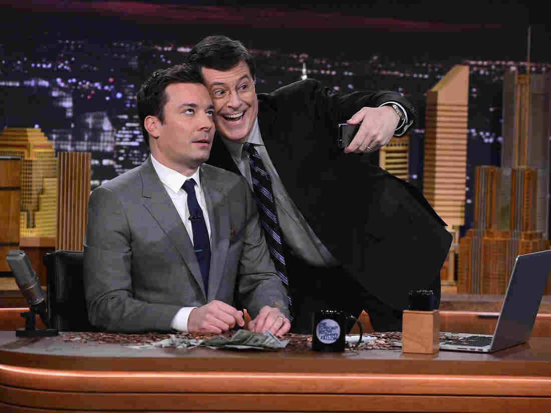 """Stephen Colbert visits The Tonight Show for Jimmy Fallon's debut --€"""" and pays up the $100 he bet that Fallon would never host it."""