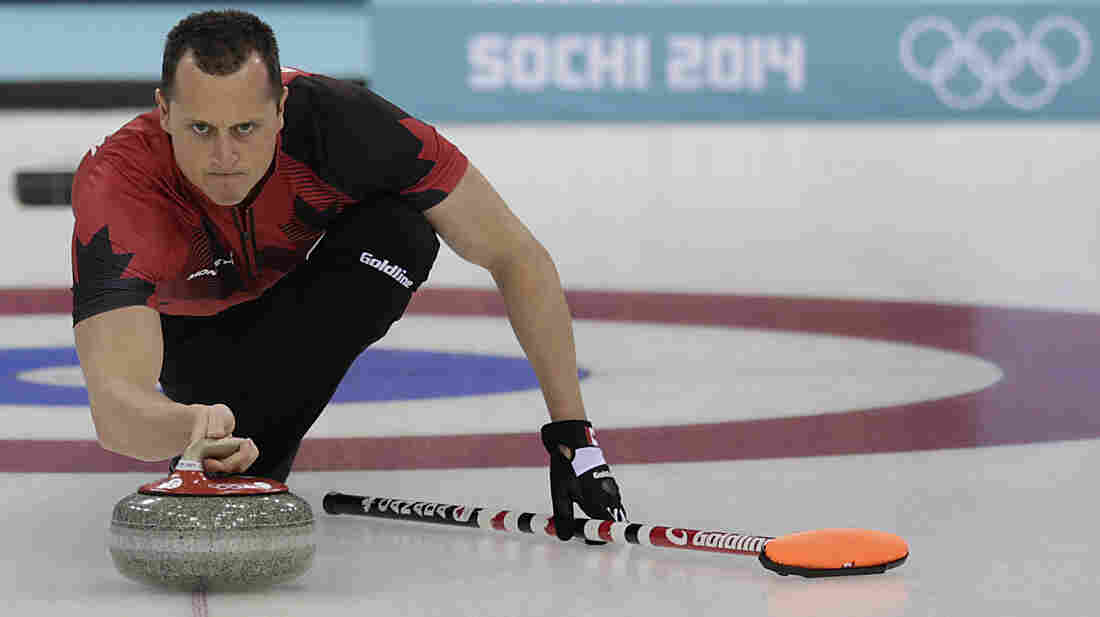 "Canada's E.J. Harnden delivers the rock during a curling training session in Sochi. ""We like to think of ourselves as athletes now and not just curlers,"" he says."