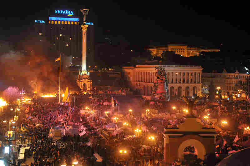 Anti-government protesters clash with the police during their storming of Independence Square in Kiev. The Associated Press reported police dismantled barricades on the perimeter of the square and set some of the protesters' tents on fire.