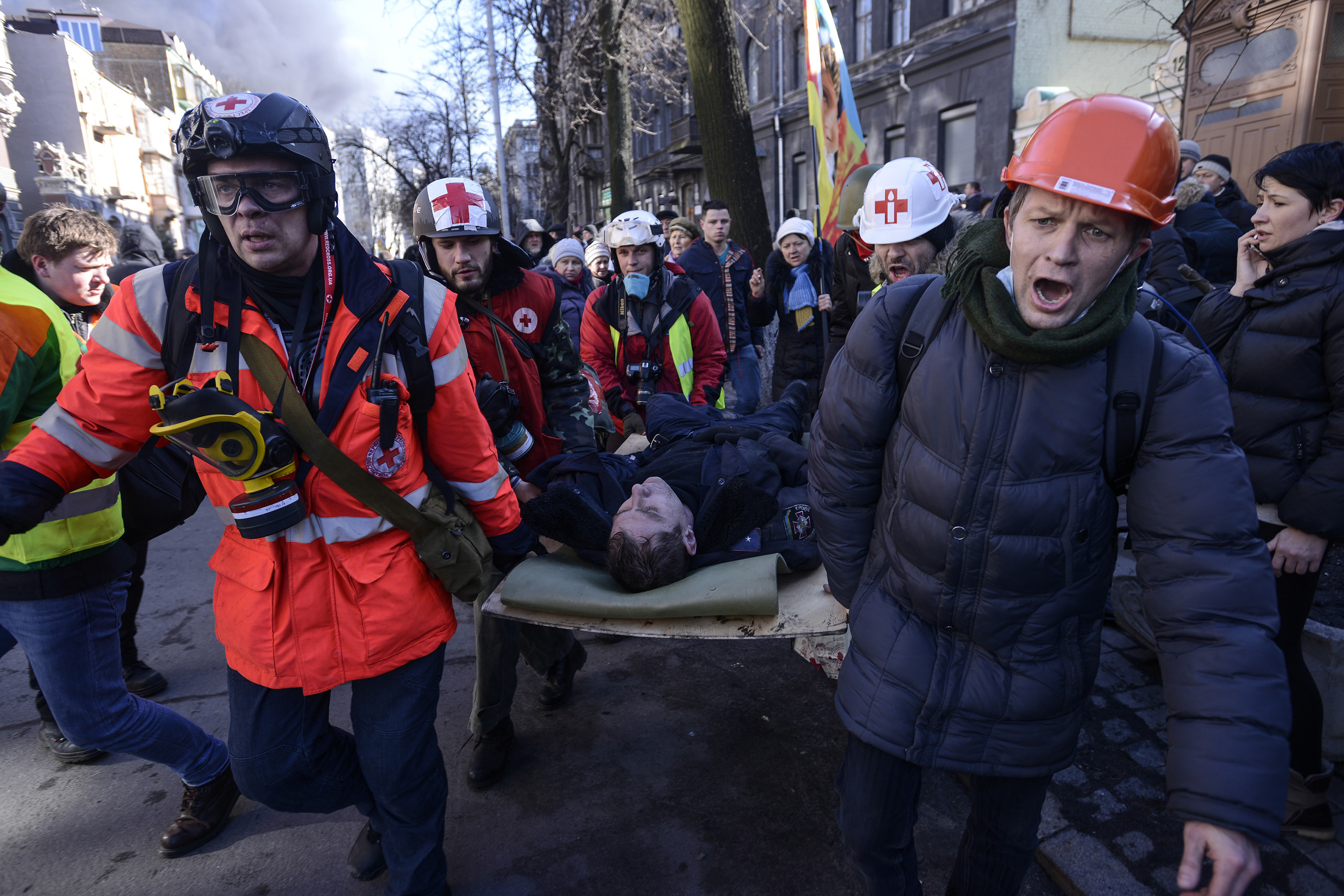 An Interior Ministry member, who was injured during clashes with anti-government protesters, is transported on a stretcher in Kiev.