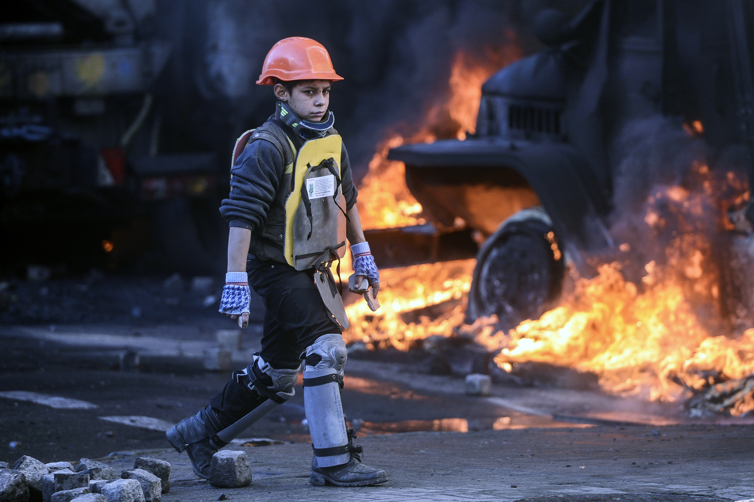 "A young anti-government protester takes part in the demonstration. Police used water cannons to disperse demonstrators near Independence Square. But, the AP noted, ""the 20,000 demonstrators fought back, armed with rocks, bats and firebombs, and singing the Ukrainian national anthem."""