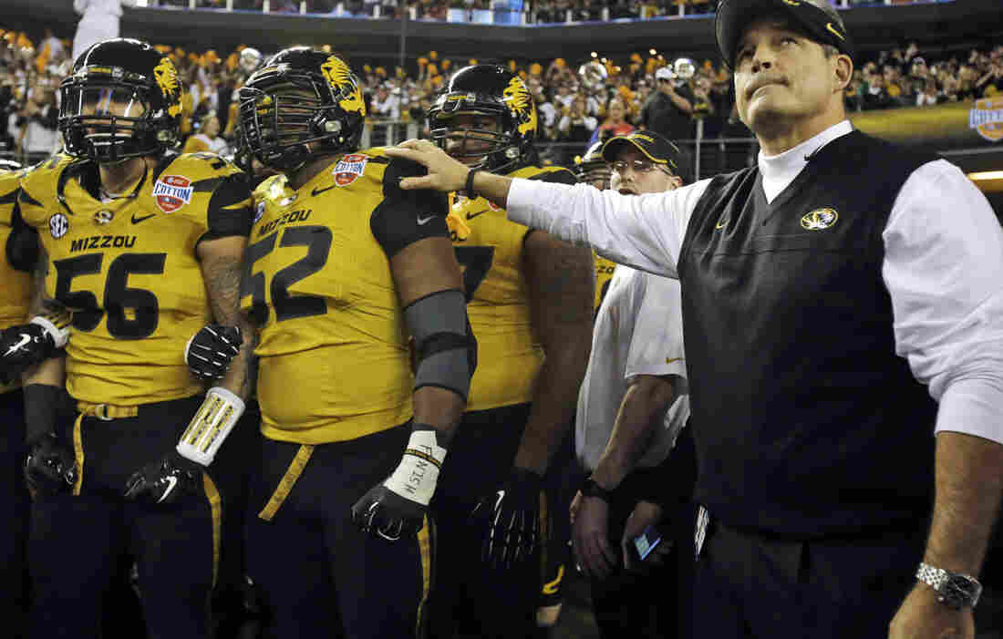 Missouri head coach Gary Pinkel with players Robert Luce (from left) and Michael Sam, ahead of the Cotton Bowl in January.