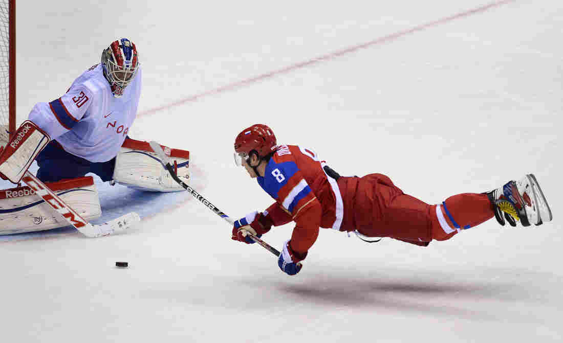 Russia's Alexander Ovechkin fights for the puck against Norway's goalkeeper Lars Haugen during the men's hockey qualification match at the Bolshoy Ice Dome during the Sochi Winter Olympics on Tuesday. Russia won 4-0, eliminating Norway from the competition.