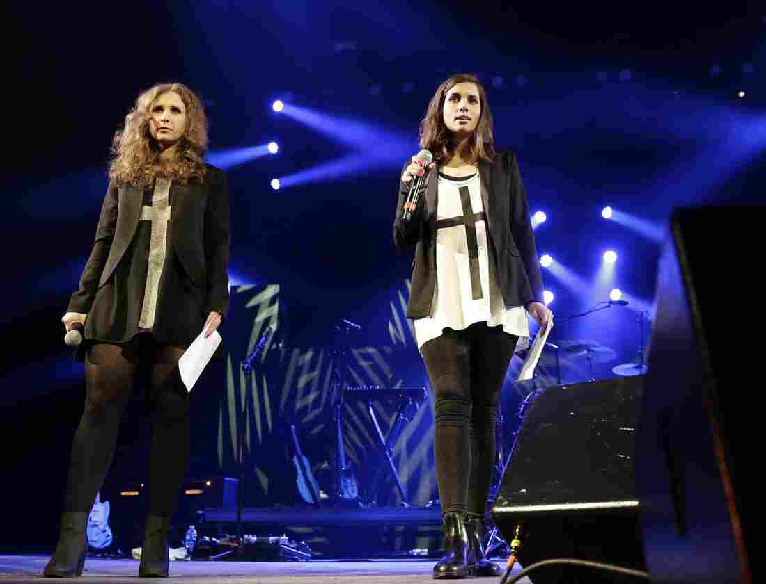"""Maria Alyokhina (left) and Nadezhda Tolokonnikova of Pussy Riot on stage at Amnesty International's """"Bringing Human Rights Home"""" concert earlier this month in Brooklyn, N.Y."""