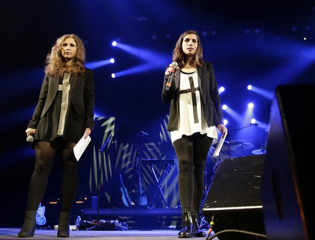 "Maria Alyokhina (left) and Nadezhda Tolokonnikova of Pussy Riot on stage at Amnesty International's ""Bringing Human Rights Home"" concert earlier this month in Brooklyn, N.Y."