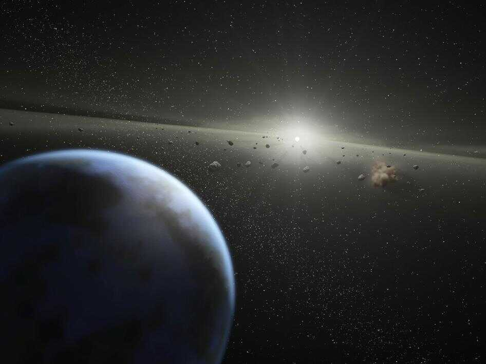 """A NASA artist's illustration of an asteroid belt around a star that's """"the same age and size as our Sun."""""""