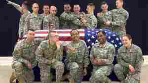 Soldiers' 'Fun' Photo With Flag-Draped Coffin Sparks Outrage