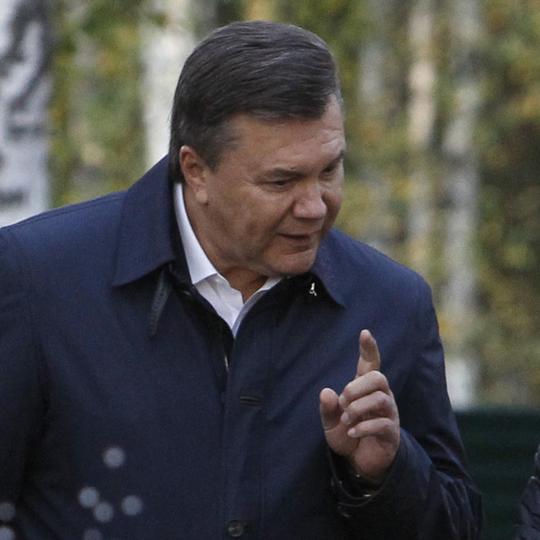 Russian Prime Minister Vladimir Putin, right, listens to Ukrainian President Viktor Yanukovich as they walk at the presidential residence in Zavidovo, about 90 miles north of Moscow, Russia, in this file photo from 2011.
