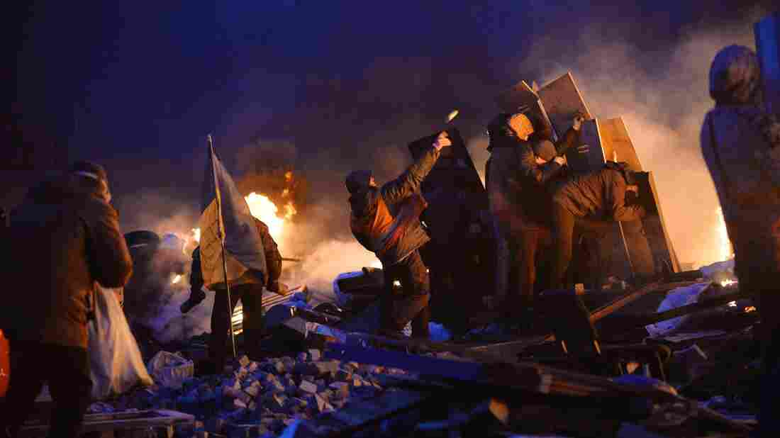 Anti-government protesters clash with police on Independence Square in Ukraine's capital Kiev early Wednesday. The protests have been going on for three months, and Tuesday was the deadliest day yet, with at least 25 reported killed.