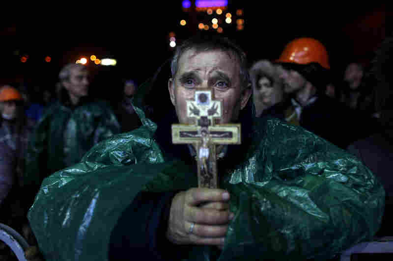 An anti-government protester holds a crucifix in Independence Square in Kiev. Late last year, President Viktor Yanukovych rejected a trade deal with the European Union in favor of closer ties with Moscow, leading to protests against his government.