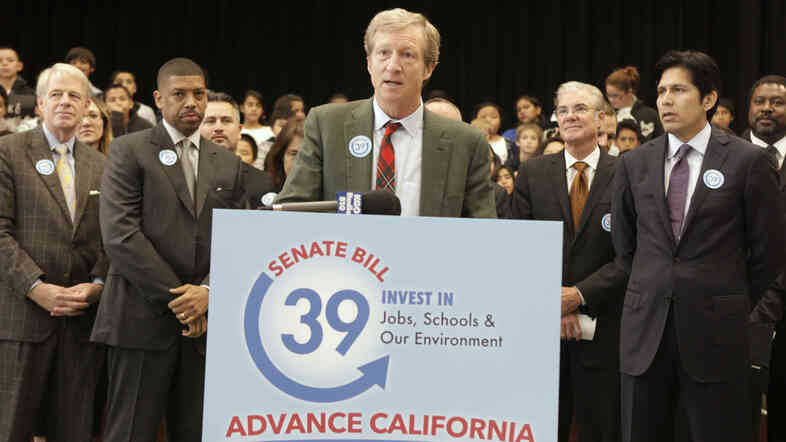 Billionaire Tom Steyer discusses a proposed bill to fund energy efficiency projects at schools in California's poorest communities during a Dec. 2012 news conference in Sacramento.