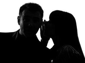 A couple shares a secret.