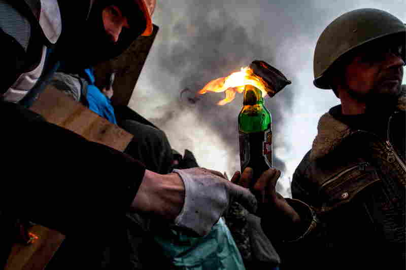 Anti-government protesters throw Molotov cocktails in Kiev's Independence Square during clashes with police. Streets and squares in Ukraine's capital are littered with rocks, bricks, spent stun grenades and tear gas canisters, rubber bullets and burning tires, the BBC's David Stern said on Morning Edition.
