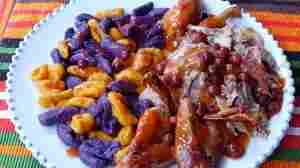 Julia della Croce often couples purple and gold gnocchi (made with two varieties of sweet potato) for a striking sight — and a delicious meal.
