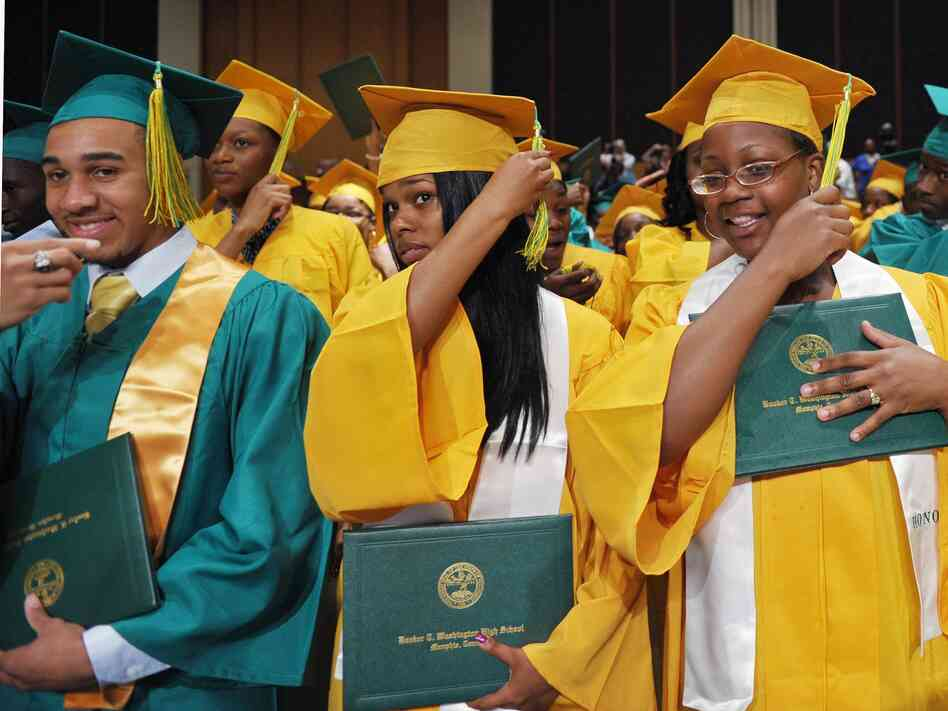 New graduates of Booker T. Washington High School adjust their tassels at their May 16, 2011, graduation ceremony in Memphis, Tenn.