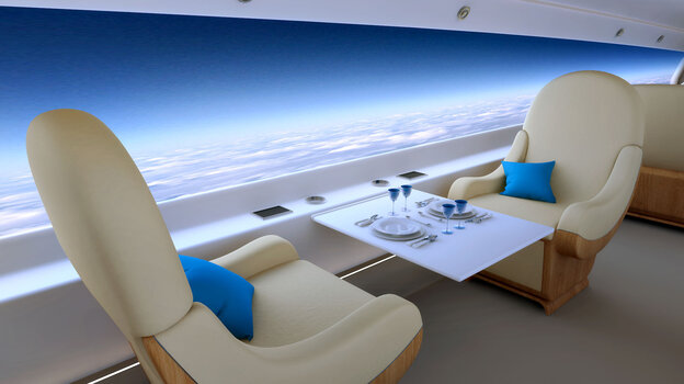 Slim screens embedded into the walls of the aircraft can be dimmed or changed to one of many stored images.