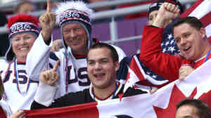 U.S. and Canadian fans attend the women's hockey gold medal game i