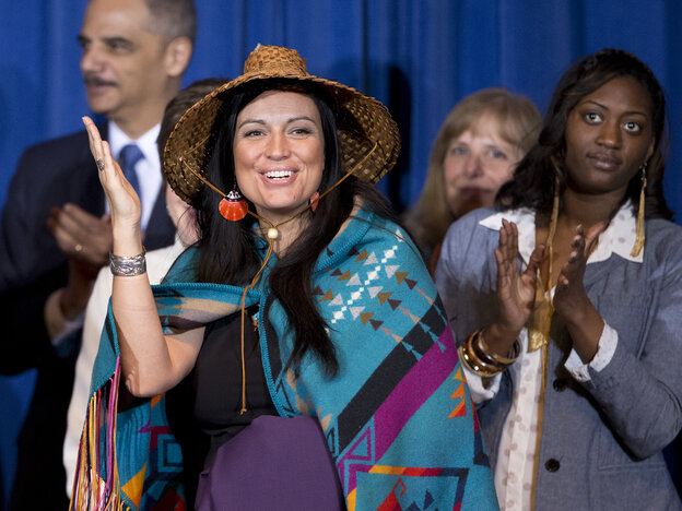 Deborah Parker, vice chair of the Tulalip Tribes of Washington state, reacts to President Barack Obama signing the Violence Against Women Ac