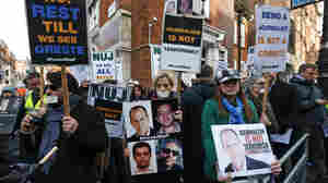 Journalists hold placards as they demonstrate across the street from Egypt's embassy in central London, on Wednesday.