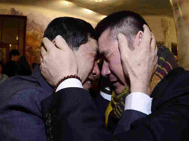 South Korean Park Yang-gon (left) and his North Korean brother Park Yang Soo get emotional as they meet Thursday during the Separated Family Reunion Meeting at Diamond Mountain resort in North Korea.