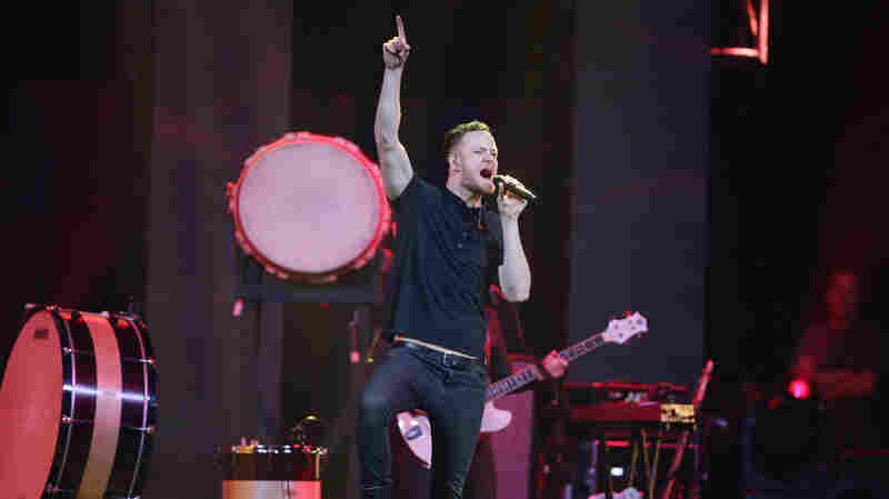 Dan Reynolds of Imagine Dragons performs onstage at the Amnesty International Concert presented by the CBGB Festival at Barclays Center on February 5, 2014 in New York City.