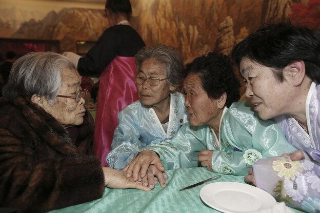 South Korean Kim Sung-yoon (left), 96, talks w