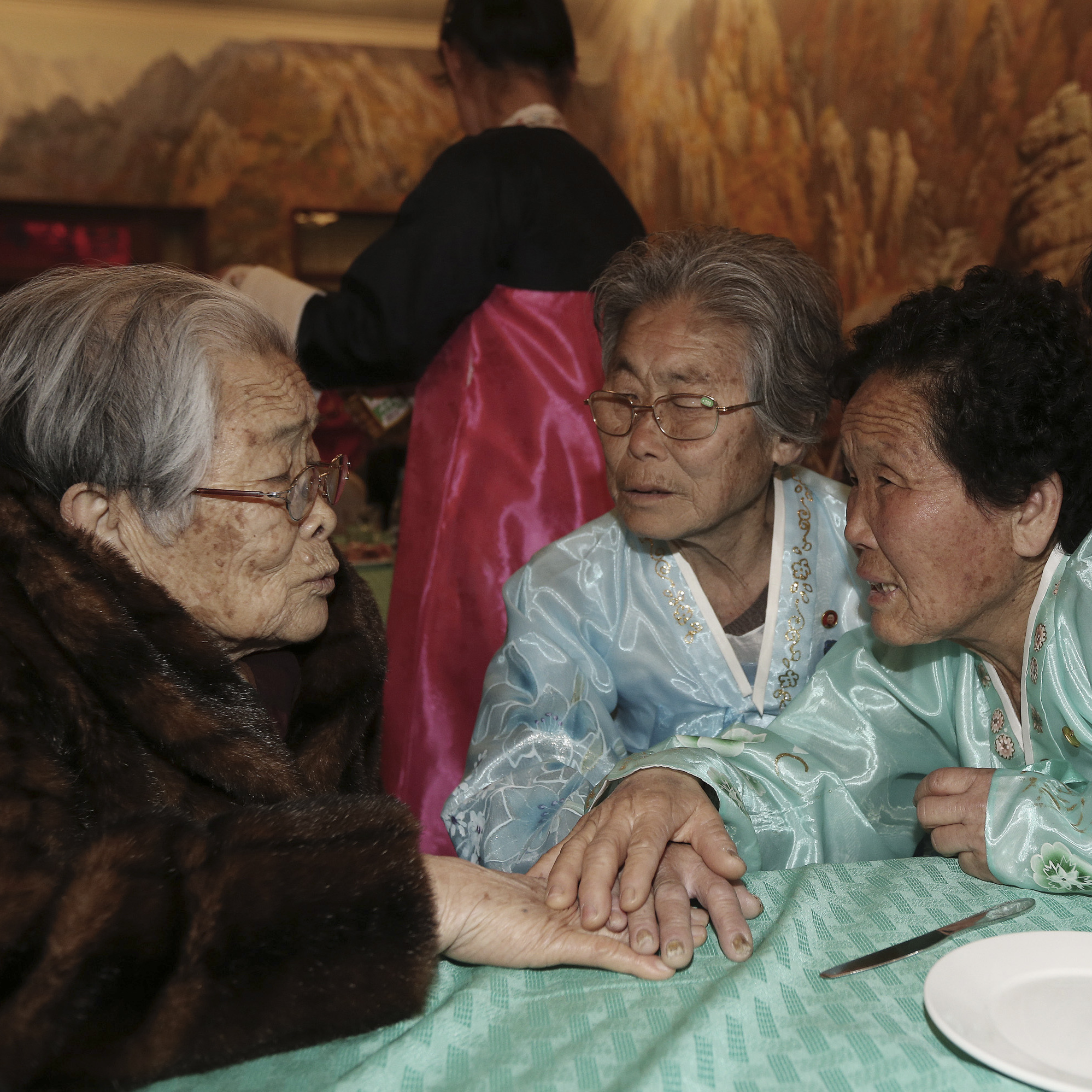 South Korean Kim Sung-yoon (left), 96, talks with her North Korean family members during the Separated Family Reunion Meeting at Diamond Mountain resort in North Korea on Thursday.