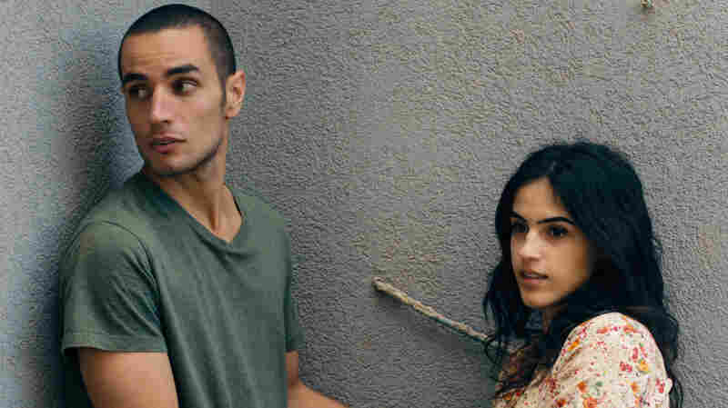 Omar (Adam Bakri) is a Palestinian baker and secret informant who braves the wall that splits his community to visit his lover, Nadia (Leem Lubany) in the Oscar-nominated film Omar.