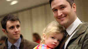 Nick Van Sickels (right) with his husband, Andrew Bond, and their daughter, Jules. The couple was legally married in Washington, D.C., but because same-sex marriage is banned in Louisiana, Bond has no parental rights.