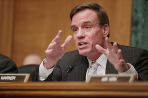 Sen. Mark Warner delivers opening remarks during a hearing on virtual currency on Capitol Hill in November 2013.