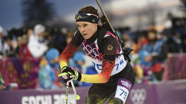 Germany's Evi Sachenbacher-Stehle has left her country's Olympic contingent — and Sochi — after testing positive for a banned stimulant. She's seen here in the biathlon earlier this week; Sachenbacher-Stehle finished fo