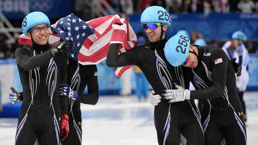 From left to right, America's J.R. Celski, Jordan Malone, Christopher Creveling and Eduardo Alvarez celebrate taking silver in the men's short track 5,000-meter relay at the Iceberg Skating Palace in the Sochi Winter Olympics Friday.