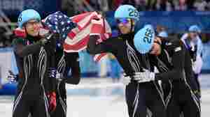 From left to right, America's J.R. Celski, Jordan Malone, Christopher Creveling and Eduardo Alvarez celebrate taking silver in the men's short track 5,000-meter relay at the Iceberg Skating Palace in the Sochi Winter Olympics Friday.