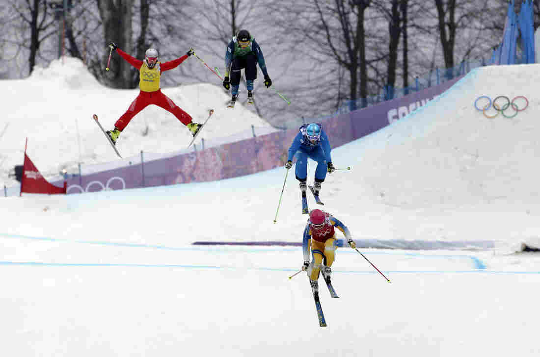 Competitors in the women's skicross small final Switzerland's Fanny Smith (left), Australia's Katya Crema, Austria's Katrin Ofner, and Sweden's Sandra Naeslund take the final jump at the Rosa Khutor Extreme Park, at the Sochi Winter Games on Friday in Krasnaya Polyana, Russia.