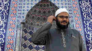 Sheikh Reda Shata stands in the men's prayer room at his mosque, The Islamic Center of Monmouth County, in Middletown, N.J., in Oct. 2011. From 2002 onward, Muslims in New Jersey allege police routinely monitored their comings and goings as part of a surveillance program.