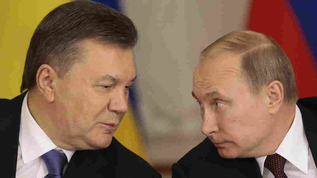 Russian President Vladimir Putin (right) and his Ukrainian counterpart, Viktor Yanukovych, chat during a news conference after talks in Moscow on Dec. 17.
